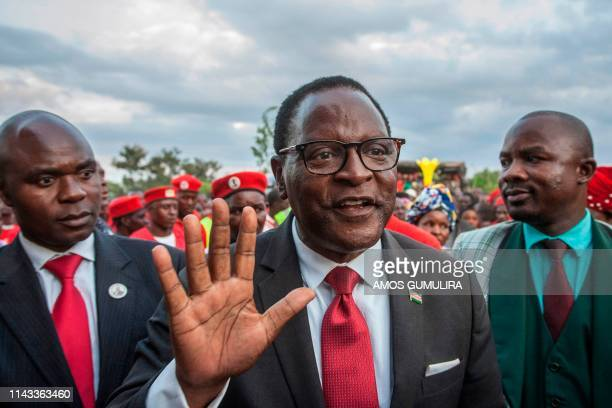 Leader of the Malawi Congress Party the main Malawi opposition party Lazarus Chakwera flanked by the party's Secretary General Eistein Mkaka and...