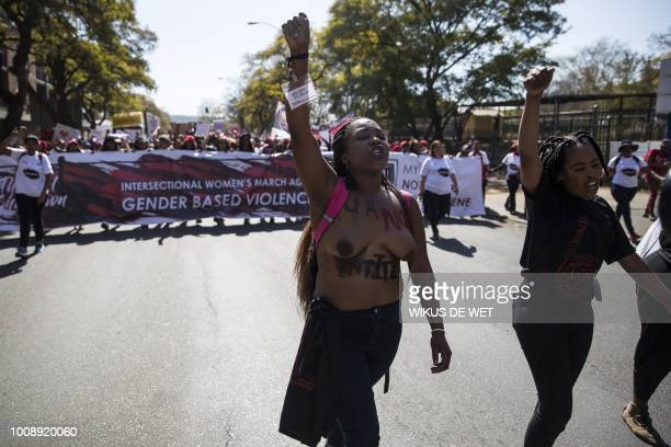 A leader of the march gestures during a march gathering women in Pretoria who are demanding sustainable action against genderbased violence through a...