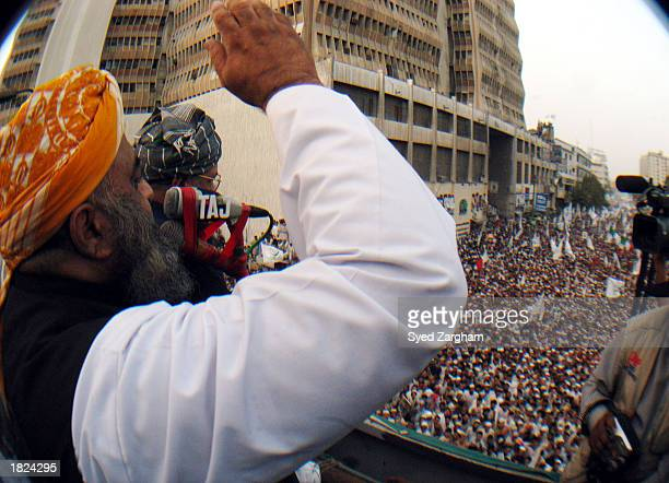 Leader of the Muttahida MajliseAmal Maulana FazalurRehman addresses protesters during a protest rally against a possible USled war with Iraq March 2...