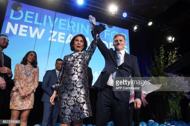 Leader of the National Party Bill English and his wife Mary react onstage at the party's election event at SkyCity Convention Centre in Auckland on...