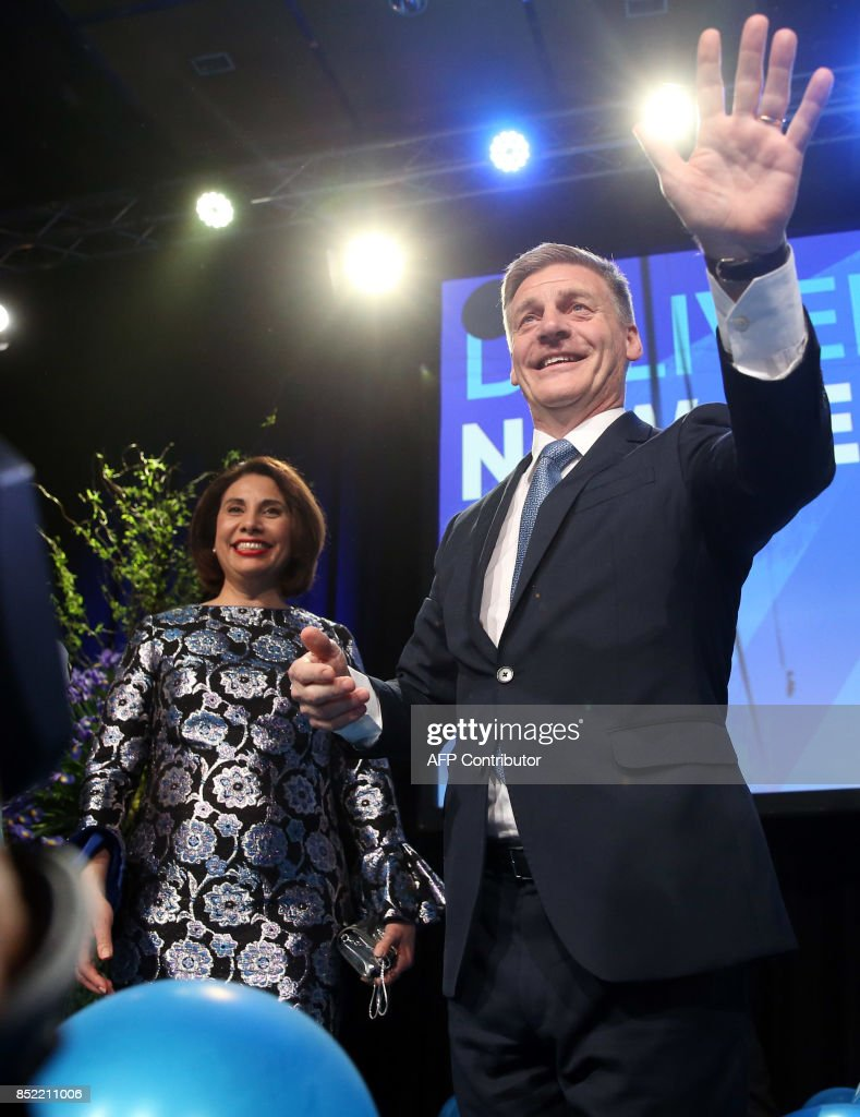 Leader of the National Party Bill English waves to supporters onstage next to his wife Mary (L) at the party's election event at SkyCity Convention Centre in Auckland on September 23, 2017. New Zealanders went to the polls on September 23 to elect a new parliament. /