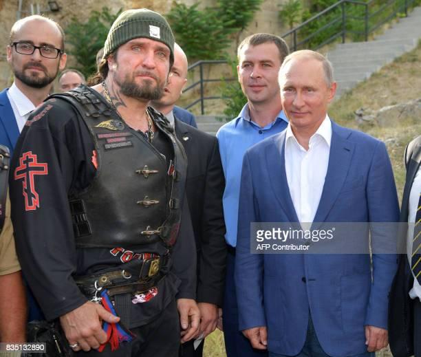 Leader of the Night Wolves Russian motorcycle club Alexander Zaldostanov aka 'Khirurg' and Russia's President Vladimir Putin visit the 35th Coastal...