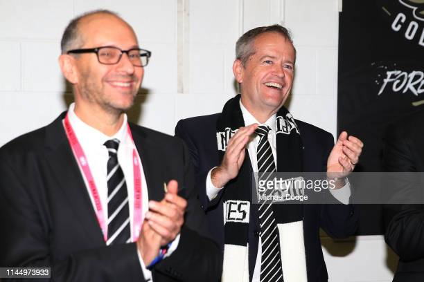 Leader Of the Oposition Bill Shorten celebrates the Collingwood Magpies win during the round 6 AFL match between Essendon and Collingwood at...