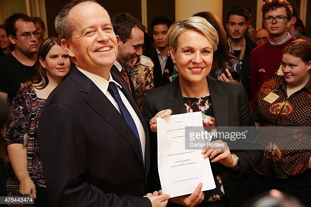 Leader of the Opposition Bill Shorten and Deputy Leader of the Opposition Tanya Plibersek pose with the samesex marriage bill during a morning tea at...