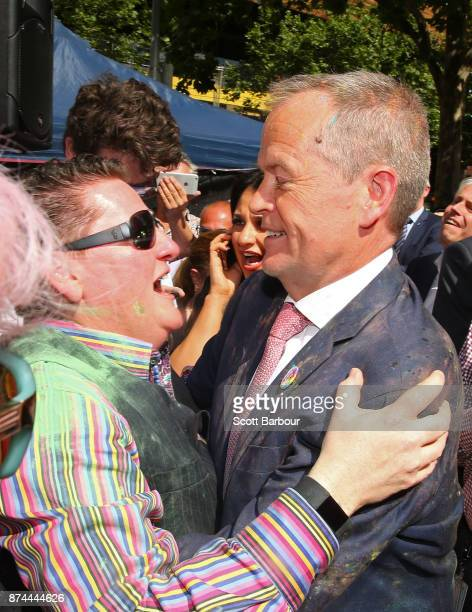 Leader of the Opposition Bill Shorten is embraced by a member of the crowd as they celebrate in the crowd during the Official Melbourne Postal Survey...