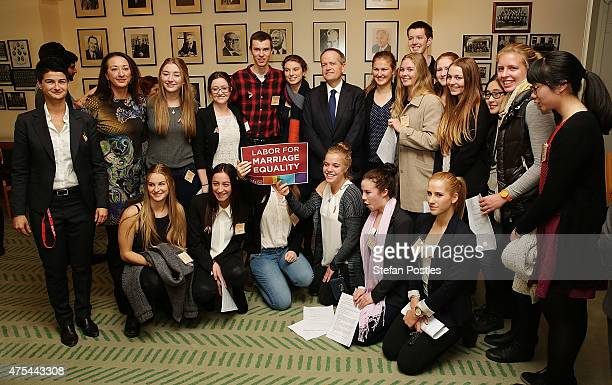 Leader of the Opposition Bill Shorten poses with supporters of marriage equality during a morning tea at Parliament House on June 1 2015 in Canberra...