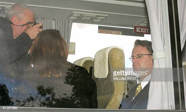 Leader of the opposition Labor Party Mark Latham looks reflective on the media bus after announcing Labor's education policies while campaigning at...