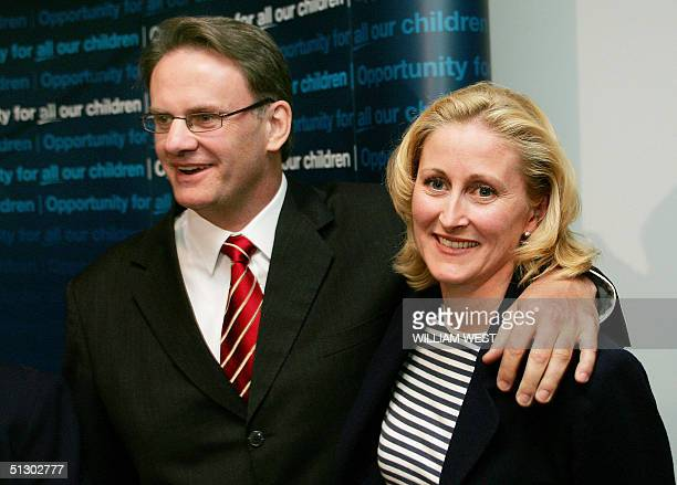 Leader of the opposition Labor Party Mark Latham smiles after giving his wife Janine Lacey a reassuring kiss after he was photographed yesterday next...