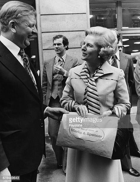 Leader of the Opposition Margaret Thatcher talking to Sir Derek Rayner chief executive of Marks and Spencer outside the Marks and Spencer department...