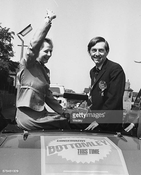 Leader of the Opposition Margaret Thatcher waving as she and Conservative Parliamentary Candidate Peter Bottomley set off on an open car tour to...