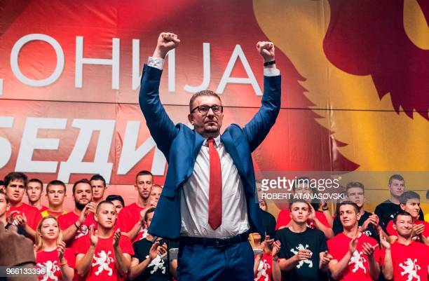 Leader of the opposition party, conservative VMRO-DPMNE, Hristijan Mickoski greets his supporters during a protest in front of the Government...