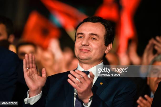 Leader of the opposition Vetevendosje party and parliamentary elections candidate Albin Kurti applauds during a closing election campaign rally in...