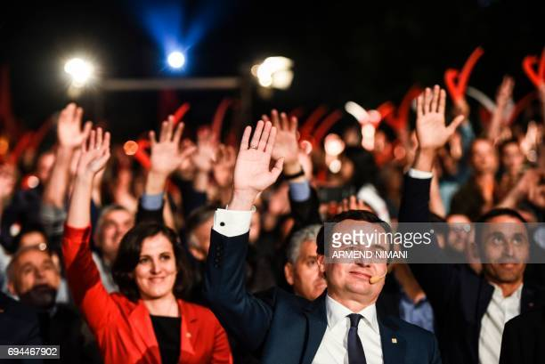 Leader of the opposition Vetevendosje party and parliamentary elections candidate Albin Kurti raises his arm during a closing election campaign rally...