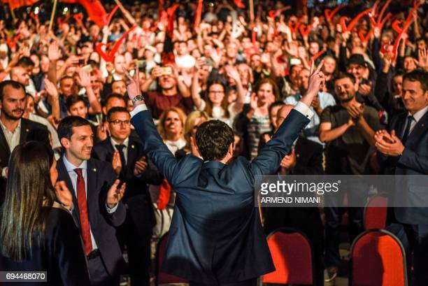 Leader of the opposition Vetevendosje party and parliamentary elections candidate Albin Kurti flashes a victory sign in front of his supporters...