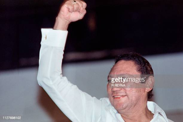 Leader of the Panamanian Defense Forces General Manuel Noriega salutes a crowd in Panama City on May 18, 1989. - Noriega made his first public...