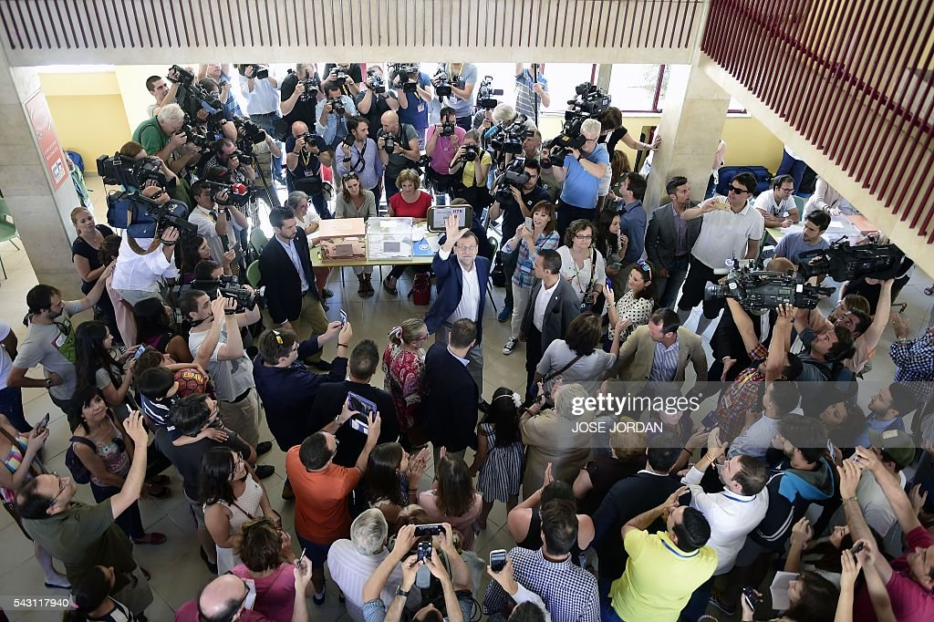 Leader of the Popular Party (PP) and Spain's caretaker Prime Minister and party candidate, Mariano Rajoy, waves before voting in Spains general election at the Bernadette college polling station in Moncloa-Aravaca, Madrid, on June 26, 2016. Spain votes today, six months after an inconclusive election which saw parties unable to agree on a coalition government. JORDAN
