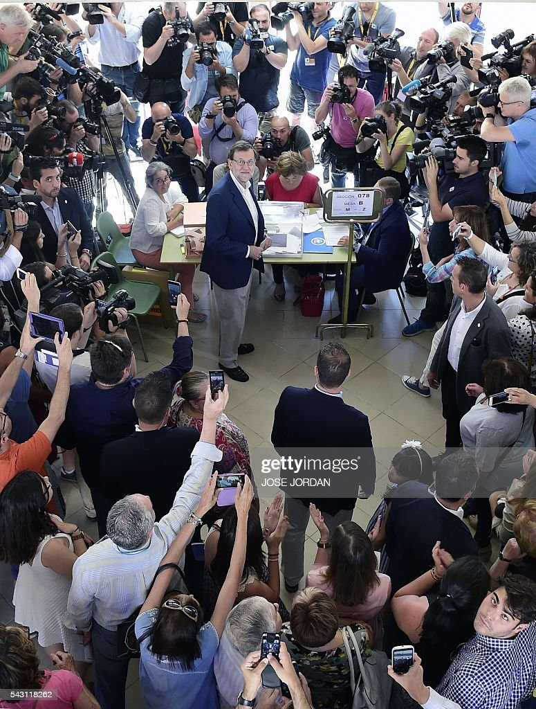 Leader of the Popular Party (PP) and Spain's caretaker Prime Minister and party candidate, Mariano Rajoy, looks up after voting in Spains general election at the Bernadette college polling station in Moncloa-Aravaca, Madrid, on June 26, 2016. Spain votes today, six months after an inconclusive election which saw parties unable to agree on a coalition government. JORDAN