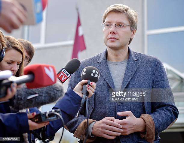 Leader of the proRussian Harmony Centre party and Mayor of Riga Nils Usakovs speaks to the press after casting his ballot at a polling station during...