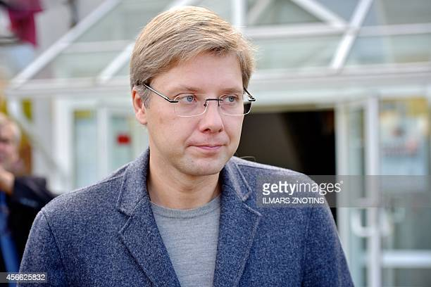 Leader of the proRussian Harmony Centre party and Mayor of Riga Nils Usakovs leaves a polling station after casting his ballot during general...