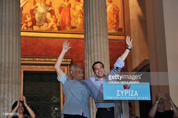Leader of the radical left Syriza party Alexis Tsipras stands alongside Greek resistance hero Manolis Glezos as they wave at party supporters on June...