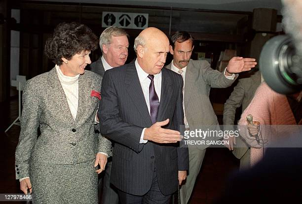 Leader of the ruling National Party Frederik Willem de Klerk with his wife Marike arrives at the Rand Afrikaans University on August 14 1989 shortly...
