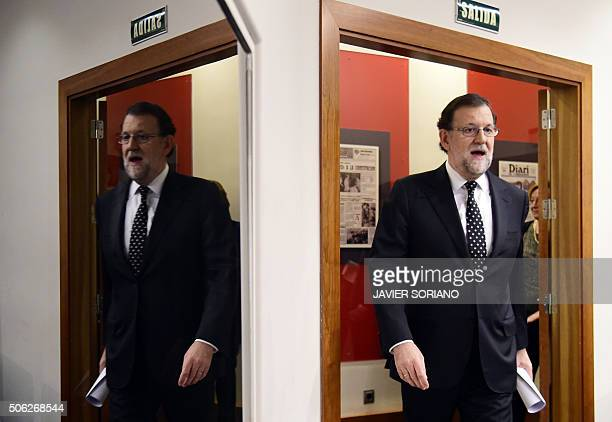 Leader of the ruling Popular Party and Spanish acting Prime Minister Mariano Rajoy arrives to give a press conference at the La Moncloa Palace,...