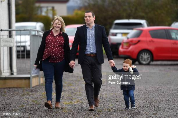 Leader of the Scottish Conservative Party Douglas Ross arrives at a polling station with his wife Krystle Ross and son Alistair at Alves Hall on May...