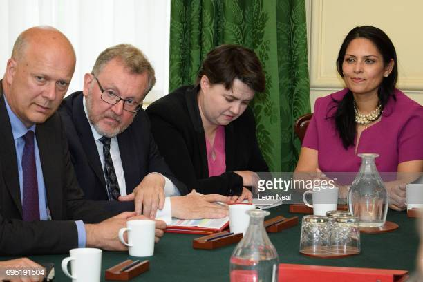 Leader of the Scottish Conservatives Ruth Davidson listens as British Prime Minister Theresa May holds the first Cabinet meeting of her new team at...