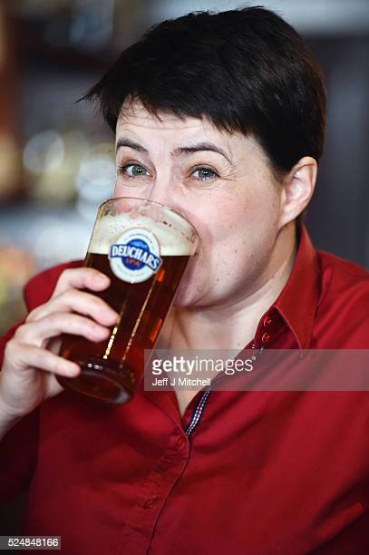 Leader of the Scottish Conservatives Ruth Davidson poses with a pint behind the bar during a visit to Raeburn Bar where she also met with staff on...