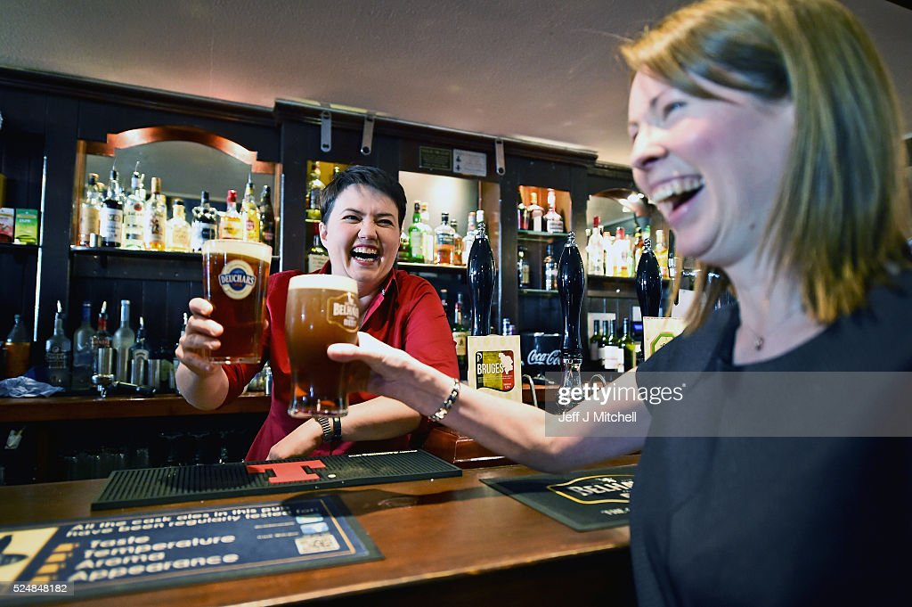 Leader of the Scottish Conservatives Ruth Davidson poses with a pint behind the bar during a visit to Raeburn Bar, where she also met with staff, on April 27, 2016 in Edinburgh, Scotland. Scotland's political parties have again been out on the streets with just eight days of campaigning left before polling day for the May 5 Holyrood election.