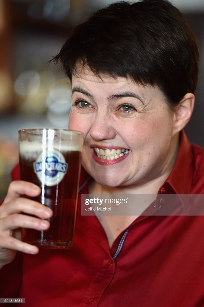 Leader of the Scottish Conservatives Ruth Davidson poses with a pint behind the bar during a visit to Raeburn Bar, where she met with staff and regulars, on April 27, 2016 in Edinburgh, Scotland. Scotland's political parties have again been out on the streets with just eight days of campaigning left before polling day for the May 5 Holyrood election.