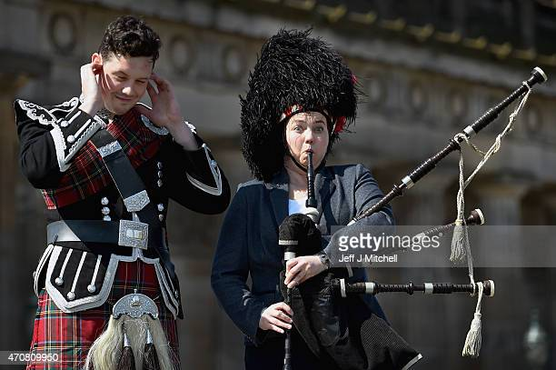 Leader of the Scottish Conservatives Ruth Davidson trys on piper Peter Wade's bear skin hat on April 23, 2015 in Edinburgh, Scotland. With two weeks...