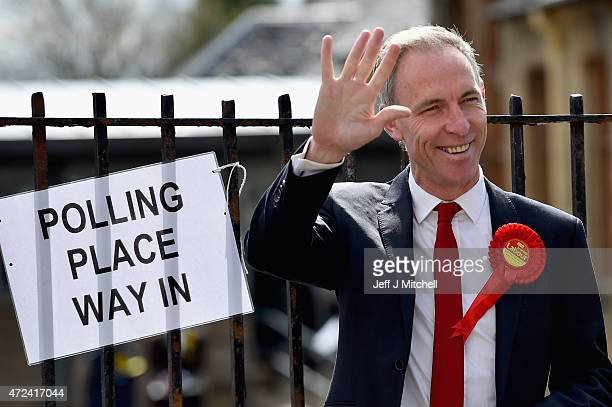 Leader of the Scottish Labour Party Jim Murphy arrives at a polling station to cast his vote on May 7 2015 in Glasgow Scotland People across Scotland...