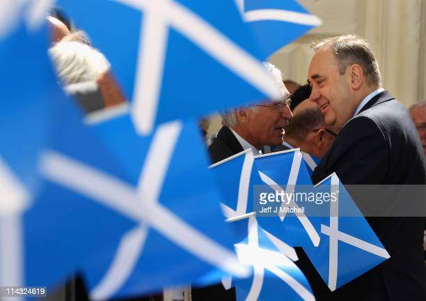 Leader of the Scottish National Party Alex Salmond leaves the Scottish Parliament after being voted in as Scotland's First Minster at the Scottish...
