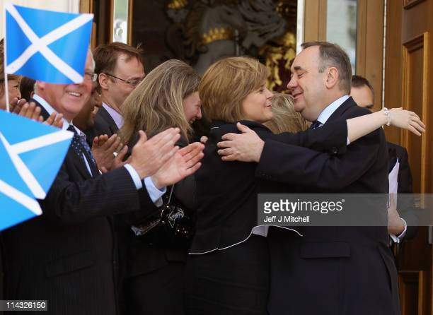 Leader of the Scottish National Party and Scotish First Minister Alex Salmond is hugged by deputy leader Nicola Sturgeon after being voted in as...