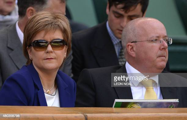 Leader of the Scottish National Party Nicola Sturgeon and her husband Peter Murrell take their seats in the royal box on centre court to watch the...