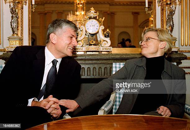 Leader of the Serbian opposition group 'Alliance for Change' Zoran Djindjic shares a laugh with Swedish Foreign Minister Anna Lindh during their...