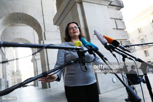 Leader of the Social Democratic Party Andrea Nahles delivers a statement as she arrives for a meeting of the coalition parties CDUCSU and SPD at the...