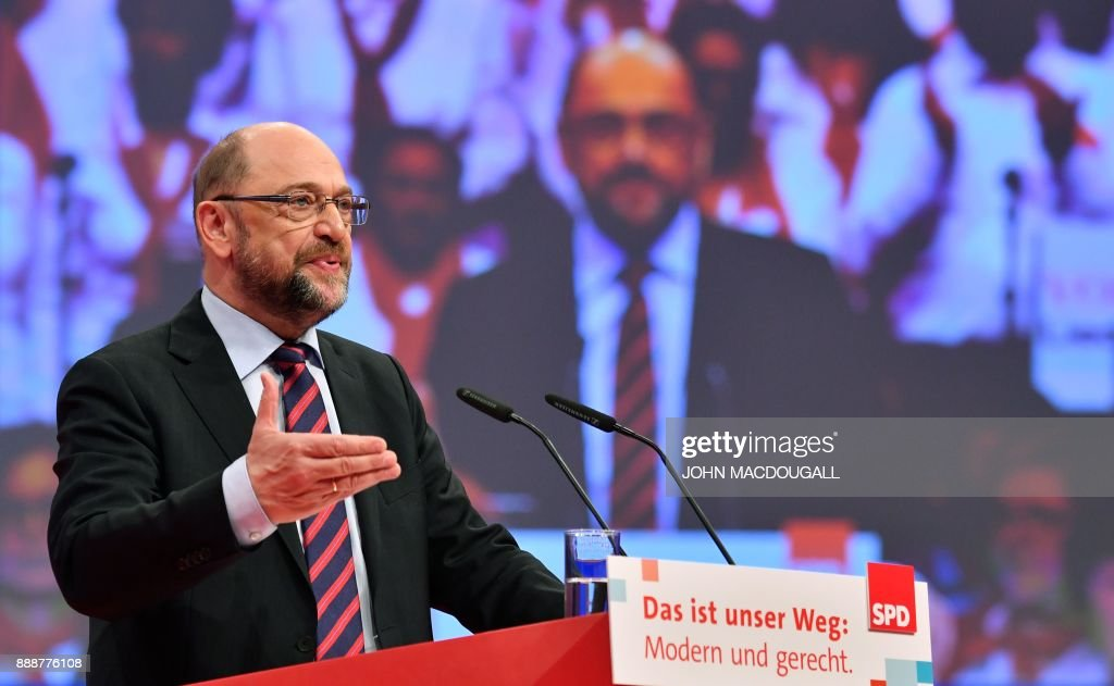 Leader of the Social Democratic Party (SPD) Martin Schulz addresses delegates on the last day of the SPD party congress on December 9, 2017 in Berlin. Germany's Social Democrats, the country's second strongest party, agreed to kick off exploratory talks with Chancellor Angela Merkel's conservatives that could lead to a new coalition government early next year. / AFP PHOTO / John MACDOUGALL