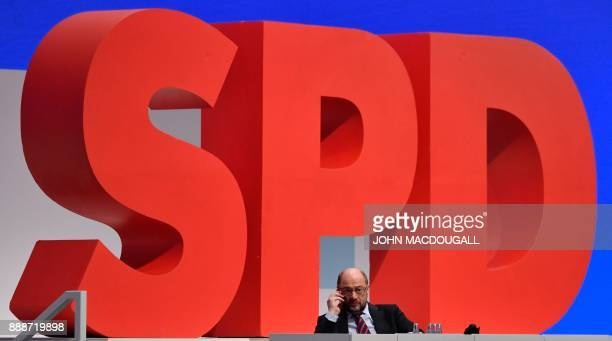 Leader of the Social Democratic Party Martin Schulz makes a phone call during the party congress of the SPD on December 9 2017 in Berlin Germany's...
