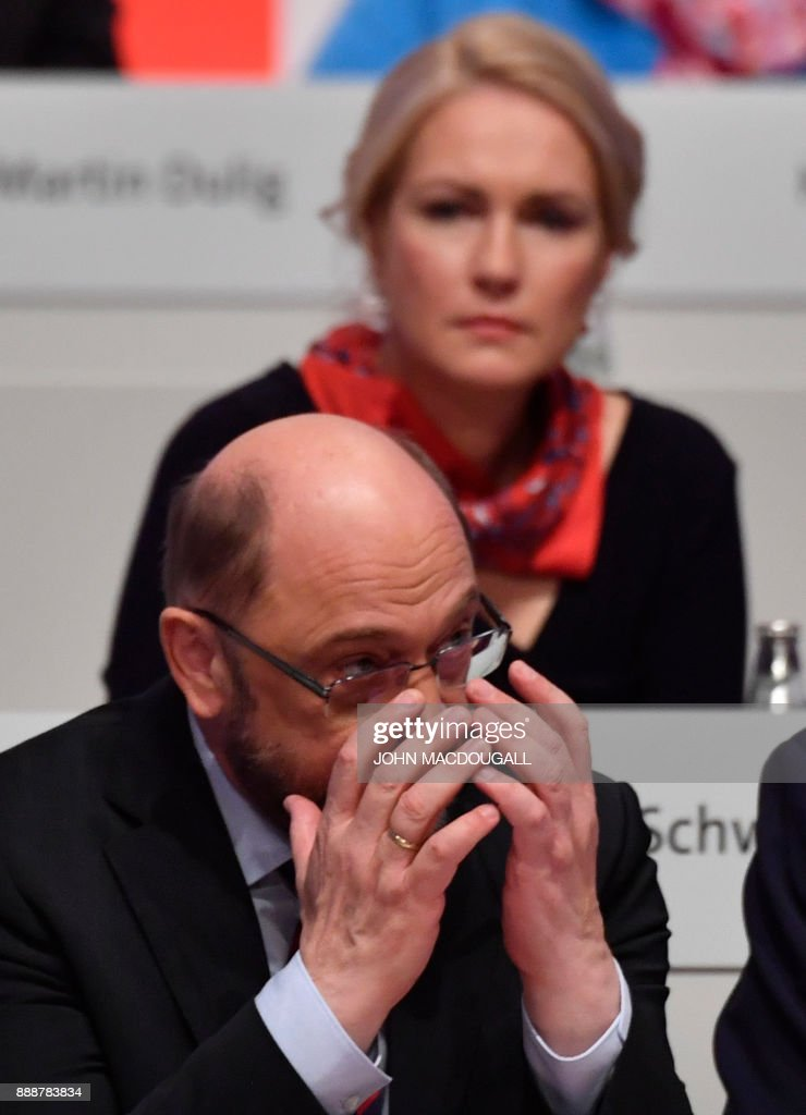 Leader of the Social Democratic Party (SPD) Martin Schulz reacts after a vote during the last day of the SPD party congress on December 9, 2017 in Berlin. Germany's Social Democrats, the country's second strongest party, agreed to kick off exploratory talks with Chancellor Angela Merkel's conservatives that could lead to a new coalition government early next year. / AFP PHOTO / John MACDOUGALL