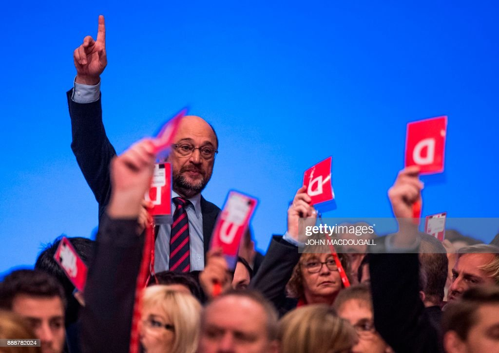 Leader of the Social Democratic Party (SPD) Martin Schulz votes by a show of hands on the last day of the SPD party congress on December 9, 2017 in Berlin. Germany's Social Democrats, the country's second strongest party, agreed to kick off exploratory talks with Chancellor Angela Merkel's conservatives that could lead to a new coalition government early next year. / AFP PHOTO / John MACDOUGALL