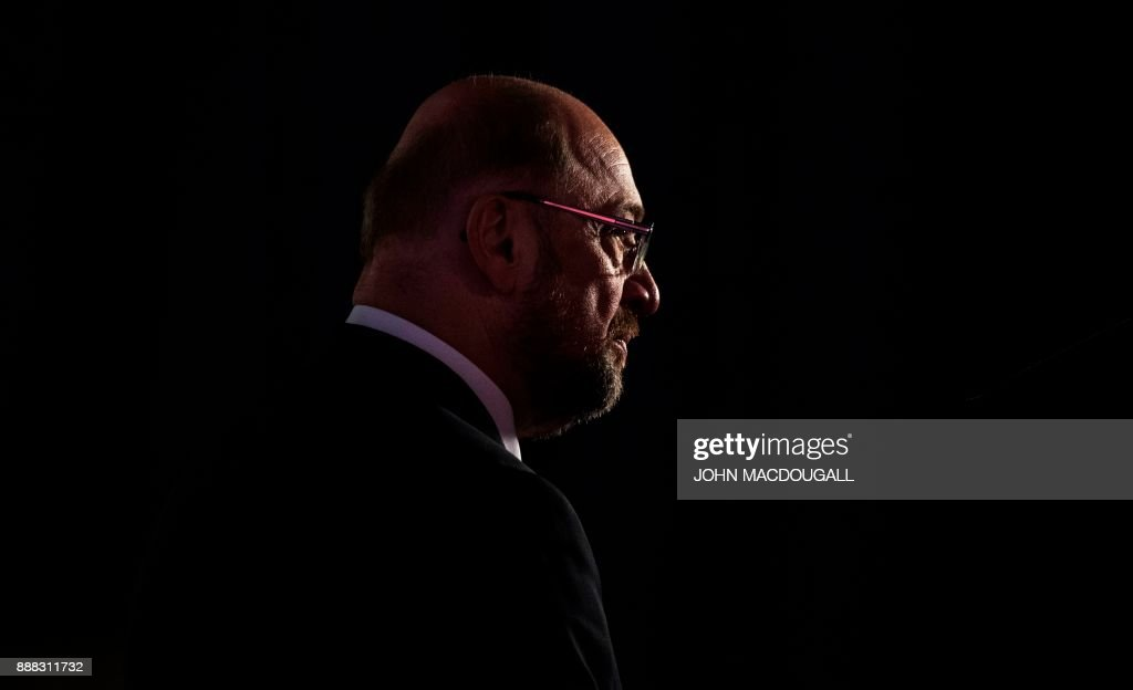 Leader of the Social Democratic Party (SPD) Martin Schulz waits to be interviewed during the party congress of the SPD on December 8, 2017 in Berlin. Germany's Social Democrats, the country's second strongest party, agreed to kick off exploratory talks with Chancellor Angela Merkel's conservatives that could lead to a new coalition government early next year. / AFP PHOTO / John MACDOUGALL