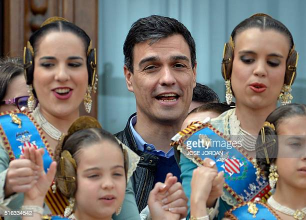 Leader of the Spanish Socialist Party Pedro Sanchez witnesses a Mascleta from the Valencia's city hall balcony surrounded by girls and womem dressed...
