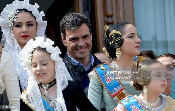"""Leader of the Spanish Socialist Party , Pedro Sanchez witnesses a """"Mascleta"""" from the Valencia's city hall balcony, surrounded by girls and womem..."""