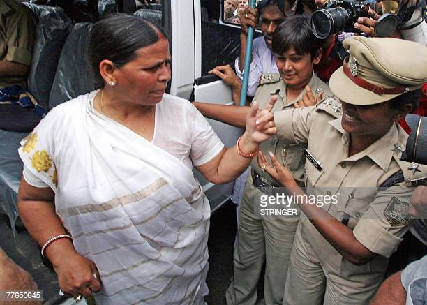 Leader of the state opposition and former Chief Minister of India's eastern state of Bihar Rabri Devi reacts as she is arrested by police during a...