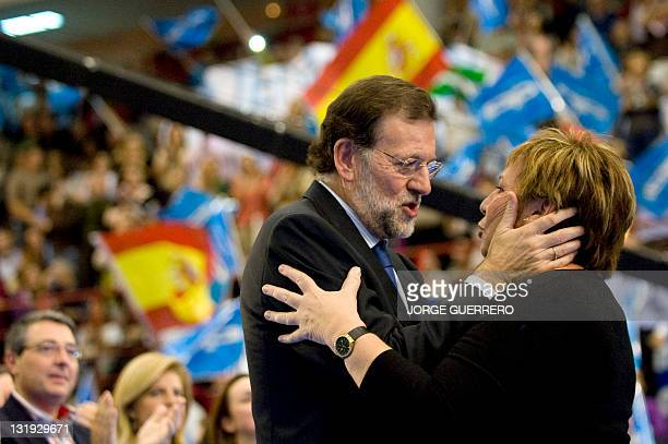 Leader of the the Spanish conservative Popular Party opposition party Mariano Rajoy congratulates deputy of the PP Celia Villalobos during a campaign...