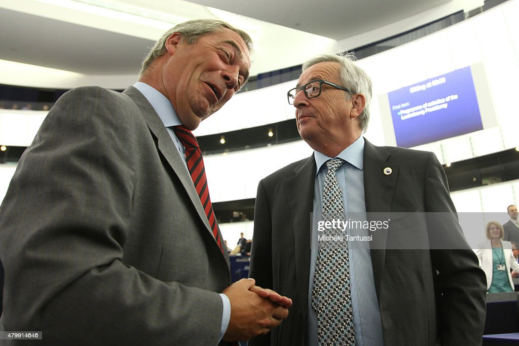 Leader of the UK Independence Party Nigel Farage chats to the President of the EU commission Jean-Claude Juncker at the European Parliament on July 8, 2015 in Strasbourg, France. Eurozone member nations have given Greece until Thursday to come up with new proposals to bring the country out of its debt crisis and qualify for further assistance from international creditors. Analysts say that should this final effort fail a departure of Greece from the Eurozone will be inevitable.