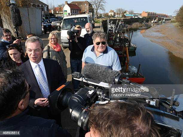 Leader of the UK Independence Party Nigel Farage speaks to local fishermen at the docks in Boston Lincolnshire on April 8 2015 Farage is campaigning...