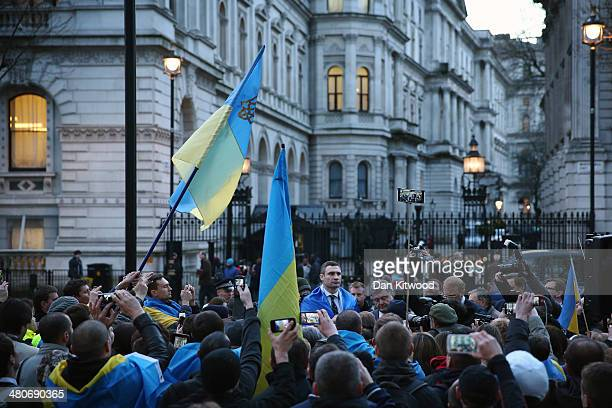 Leader of the Ukrainian Democratic Alliance for Reform party Vitaly Klitschko greets Ukrainian nationals as they stage a protest outside Downing...